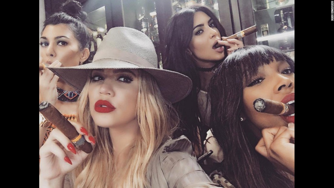"Television personality Khloe Kardashian, second from left, <a href=""https://www.instagram.com/p/BFAKLFGBRgY/"" target=""_blank"">smokes a cigar</a> in this selfie she posted from Cuba on Wednesday, May 4. Joining her, from left, are sisters Kourtney and Kim and friend Malika Haqq."