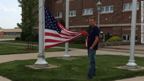 18-year-old Cole Dotson of Continental, Ohio, keeps the flag from touching the ground.