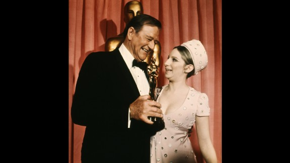 John Wayne with his Oscar and Barbra Streisand