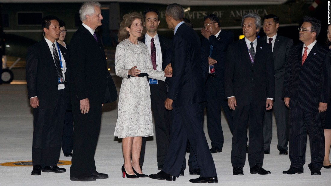 Obama is greeted by U.S. Ambassador to Japan Caroline Kennedy and her husband, Edwin Arthur Schlossberg, at the airport in Tokoname, Japan, on May 25.
