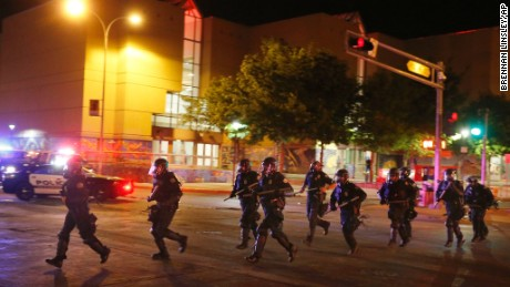 Riot police respond to anti-Trump protests following a rally and speech by Republican presidential candidate Donald Trump, in front of the Albuquerque Convention Center where the event was held, in Albuquerque, N.M., Tuesday, May 24, 2016. (AP Photo/Brennan Linsley)