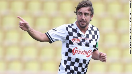 Fernando Alonso enjoys one of his goals in the pre-Monaco Grand Prix charity soccer match.