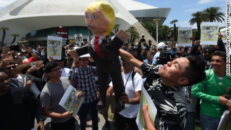 Protestors gather outside the Anaheim Convention Center with an effigy of Donald Trump prior to a rally for the Republican presidential candidate on May 25, 2016 in Anaheim, California. / AFP / Mark Ralston        (Photo credit should read MARK RALSTON/AFP/Getty Images)