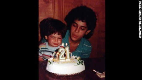 Debbie Franczek blows out the candles on her 21st birthday with her son, Matt.