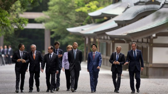 From left: Italian Prime Minister Matteo Renzi, European Commission President Jean-Claude Juncker, French President François Hollande, Canadian Prime Minister Justin Trudeau, German Chancellor Angela Merkel, U.S. President Barack Obama, Japanese Prime Minister Shinzo Abe, European Council President Donald Tusk and British Prime Minister David Cameron walk past the Kagura-den as they visit Ise Jingu shrine in Ise, Japan, on Thursday, May 26. Obama is visiting Japan and Vietnam during his 10th trip to Asia.