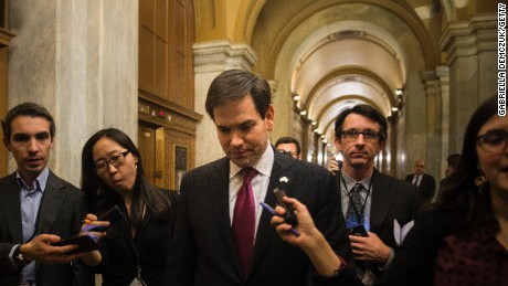 Sen. Marco Rubio makes a quick exit after voting on the Senate floor at the Capitol on February 10, 2016.