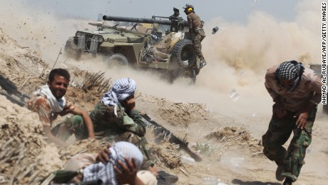 Iraqi pro-government forces fire an anti-tank cannon near the village of al-Sejar on May 25.