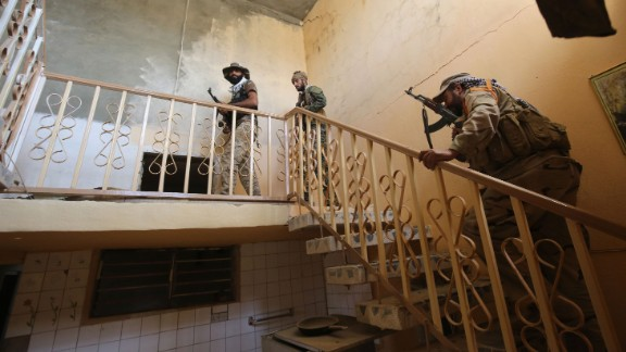 Iraqi government forces join an operation in al-Shahabi on May 24.