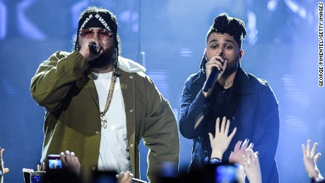 Rapper Belly and The Weeknd perform at the 2016 Juno Awards at Scotiabank Saddledome in April 3 in Calgary, Canada.
