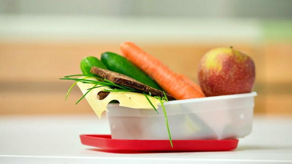 GOETTINGEN, GERMANY - SEPTEMBER 19: Healthy breakfast, lunchbox filled with wholewheat bread, fruit and vegetables on September 19, 2014, in Goettingen, Germany.