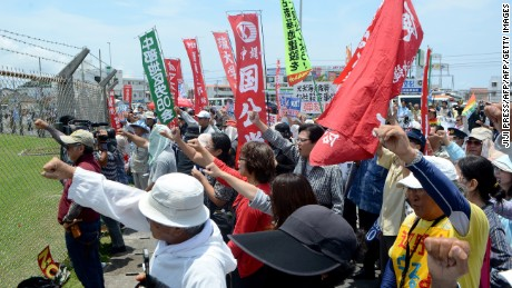 People protest against the U.S. military presence at the U.S. Kadena Air Base in Cyatan, Okinawa prefecture,   May 21, 2016.