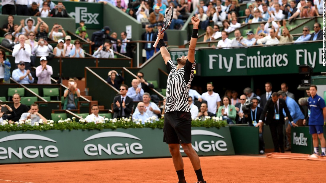 Jo-Wilfried Tsonga was in good spirits, too. France's top men's hope  at Roland Garros, he rallied to defeat fellow Australian Open finalist Marcos Baghdatis 6-7 (6-8) 3-6 6-3 6-2 6-2.