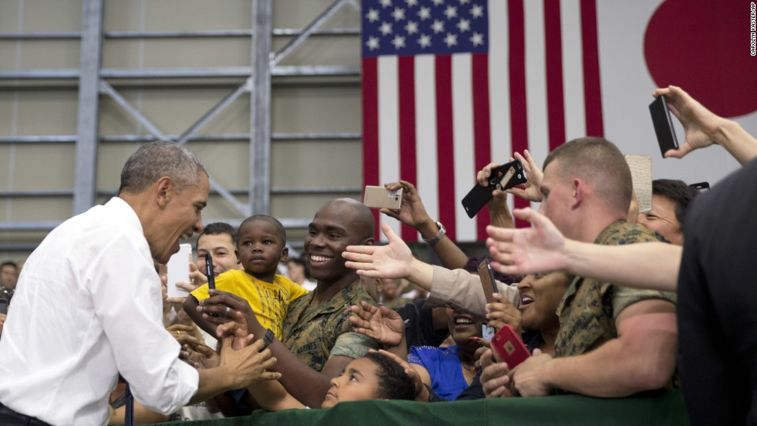 President Obama greets members of the U.S. and Japanese military as he arrives at Marine Corps Air Station Iwakuni in Iwakuni on May 27.