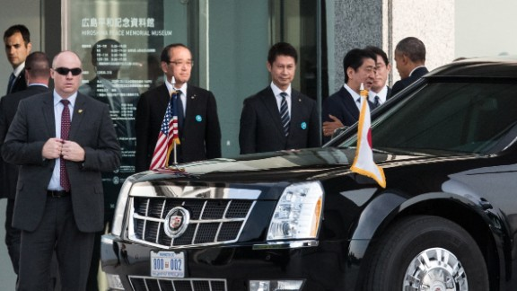 President  Obama, right, is greeted Japanese Prime Minister Shinzo Abe upon arriving at the Hiroshima Peace Memorial Park.