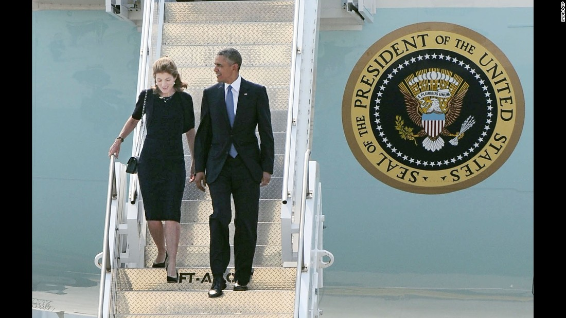 President Barack Obama and U.S. Ambassador to Japan Caroline Kennedy arrive at the Marine Corps' Air Station Iwakuni in the western Japanese city.