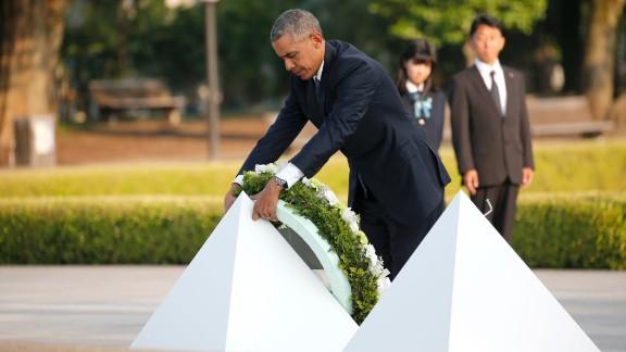 President Obama lays a wreath at Hiroshima Peace Memorial Park Friday.