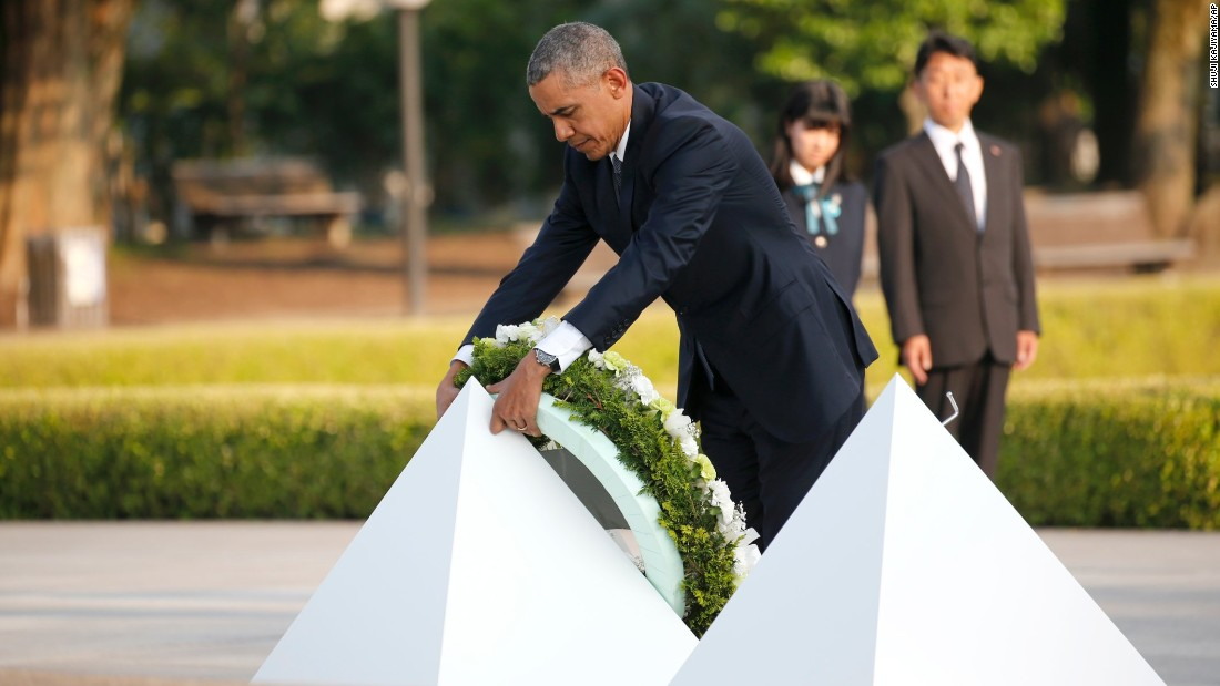 President Obama lays a wreath at Hiroshima Peace Memorial Park Friday.