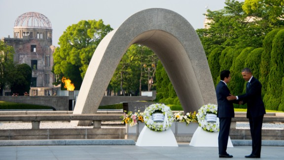 """President Barack Obama and Japanese Prime Minister Shinzo Abe shake hands after laying wreaths at the Hiroshima Peace Memorial Park in Hiroshima on Friday, May 27. Obama, the first sitting president to visit Hiroshima, called for a """"world without nuclear weapons,"""" during his speech but his remarks stopped short of an apology."""