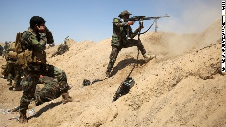 Iraqi government forces engage with ISIS forces near the village of al-Sejar, northeast of Falluja, on May 26.