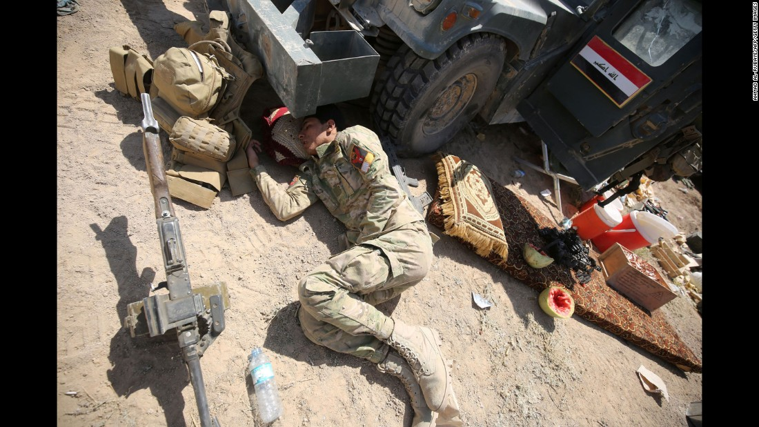 A pro-government fighter rests after battling ISIS near al-Sejar on May 26.