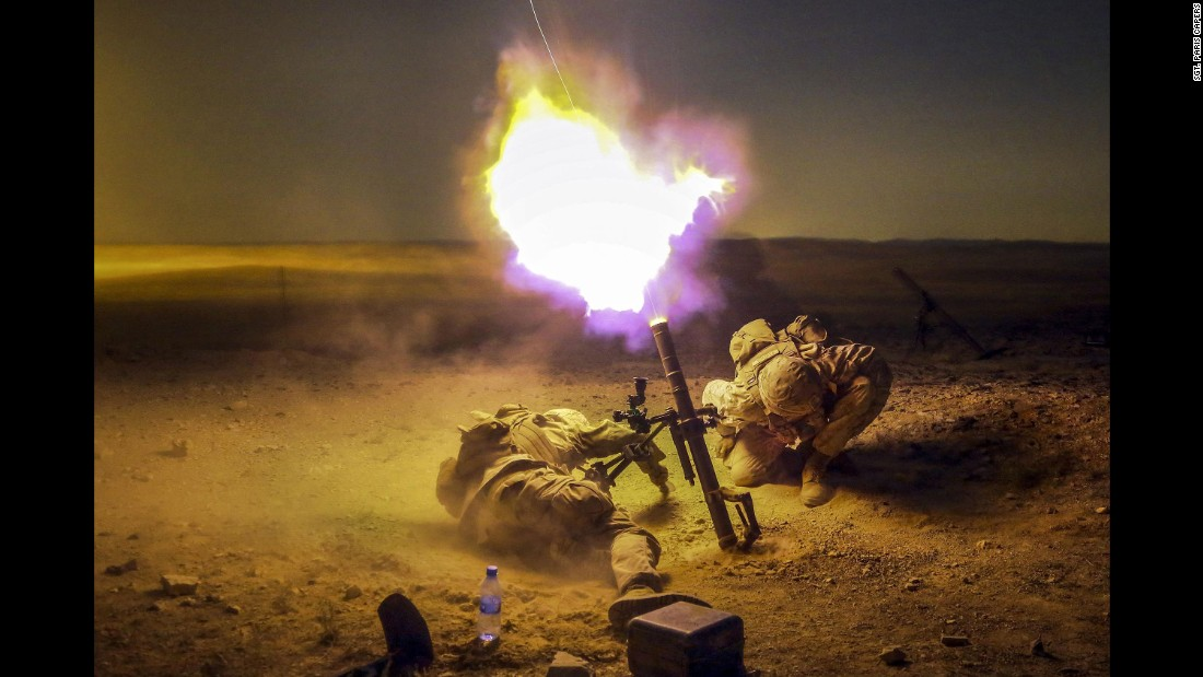 Marine Lance Cpl. Zach King, left, and Cpl. Derick Sammonek brace themselves as they fire a mortar during a training exercise in Jordan on Sunday, May 15.