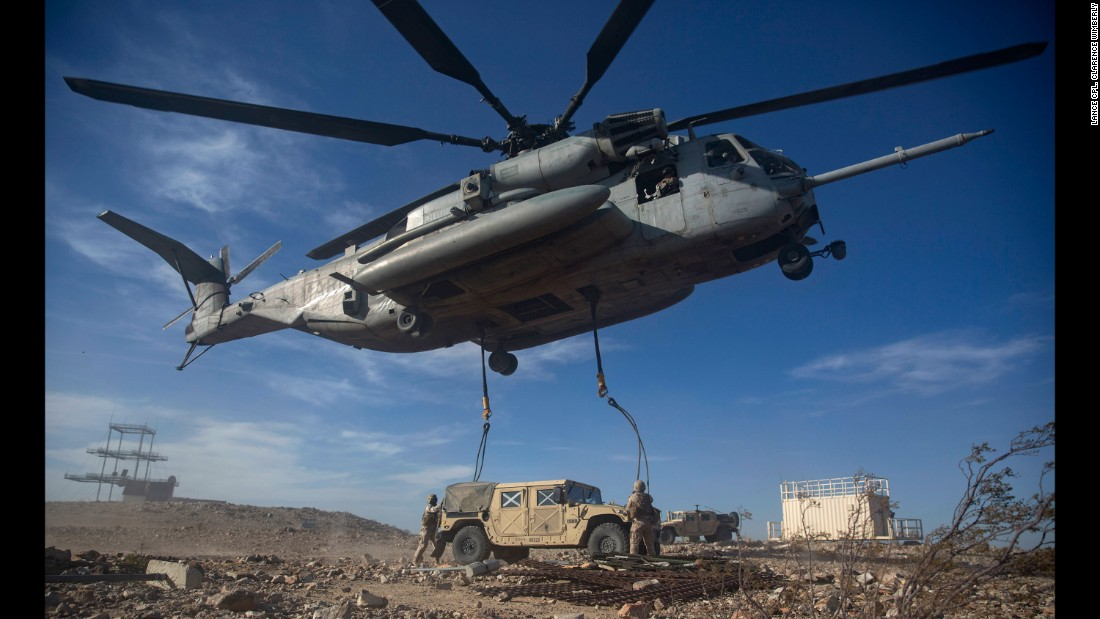 U.S. Marines anchor ropes to a Humvee during a training exercise in Twentynine Palms, California, on Friday, May 13.