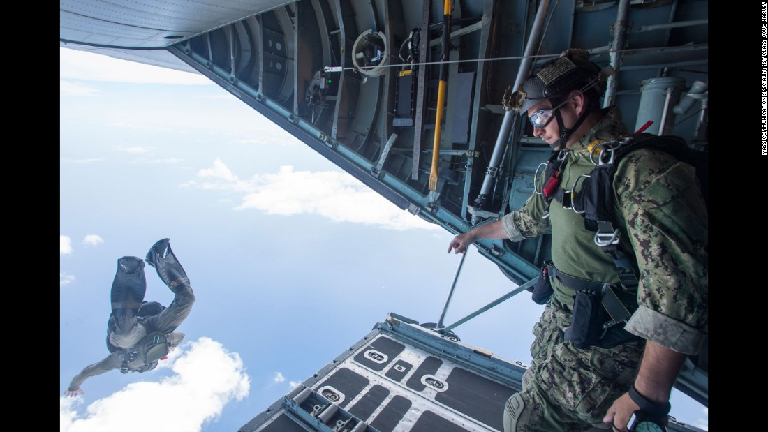 Members of the U.S. Navy jump from a C-130 Hercules during an exercise off the coast of Guam on Wednesday, May 18.