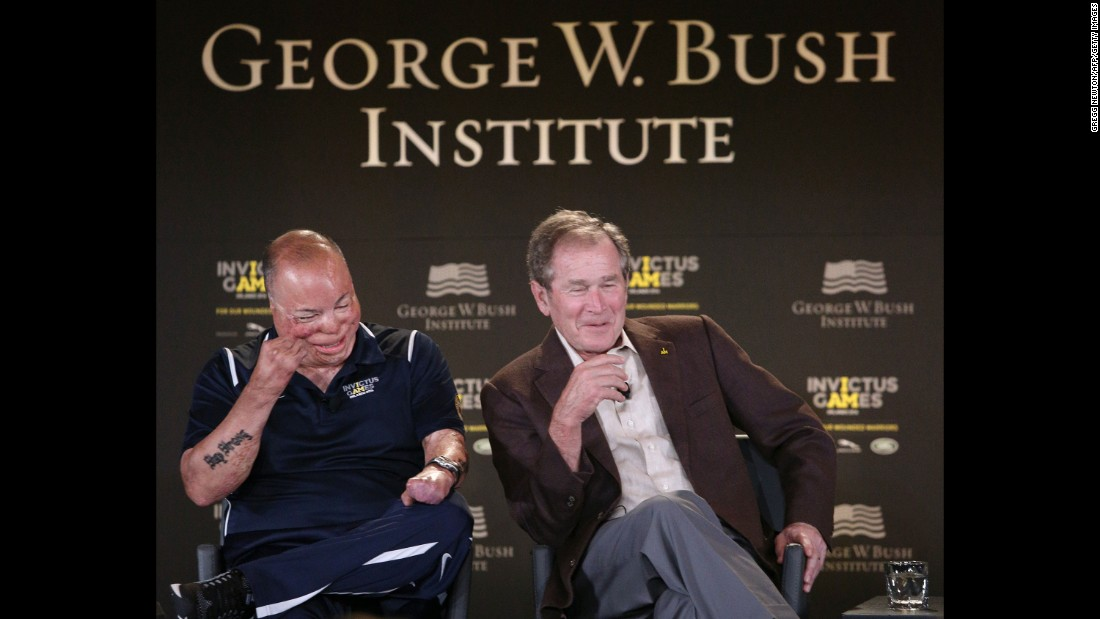 Former U.S. President George W. Bush, right, and Air Force Master Sgt. Israel Del Toro Jr. laugh at a joke during an Invictus Games symposium on Sunday, May 8. The Invictus Games, which took place in Florida this year, were created by Britain's Prince Harry for wounded, injured and sick service members. Fifteen countries competed in the sports competition this year.