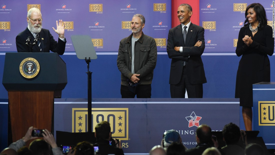 Former talk-show host David Letterman speaks during the 75th Anniversary USO Show on Thursday, May 5. Joining him on stage, from left, are host Jon Stewart, U.S. President Barack Obama and first lady Michelle Obama.