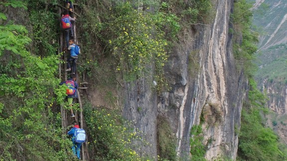 Atule'er, a village in China's Sichuan province, received widespread attention after state-run Beijing News published a series of photos of students climbing vine ladders along a 800-meter (half-mile) cliff to go to school.