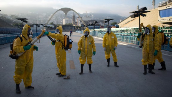FILE - In this Tuesday, Jan. 26, 2016  file photo, health workers get ready to spray insecticide to combat the Aedes aegypti mosquitoes that transmits the Zika virus, under the bleachers of the arena in Rio de Janeiro, which will be used for the Archery competition in the 2016 summer games. More than 145 public health experts signed an open letter to the World Health Organization on Friday, May 27, 2016 asking the U.N. health agency to consider whether the Rio de Janeiro Olympics should be postponed or moved because of the ongoing Zika outbreak. The letter calls for the games to be delayed or relocated in the name of public health. (AP Photo/Leo Correa, File)