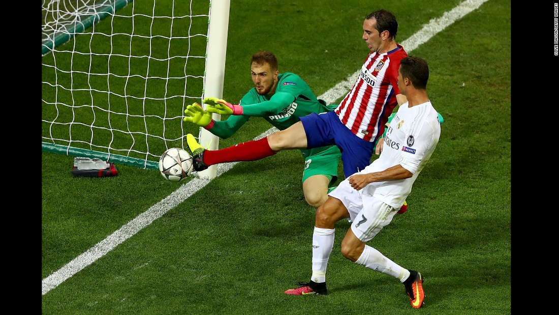 Atletico Madrid's Jan Oblak and Diego Godin combine to stop a chance on goal by Cristiano Ronaldo.