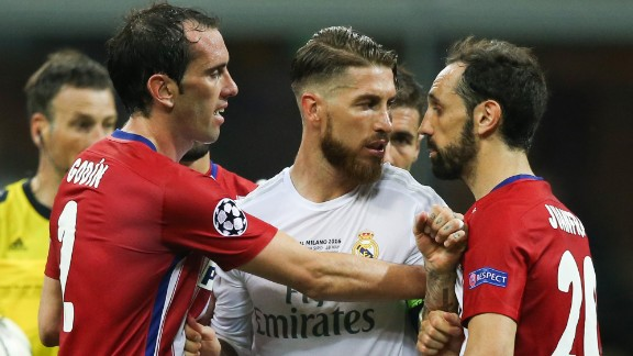 Godin of Atletico Madrid separates Ramos and Juanfran.