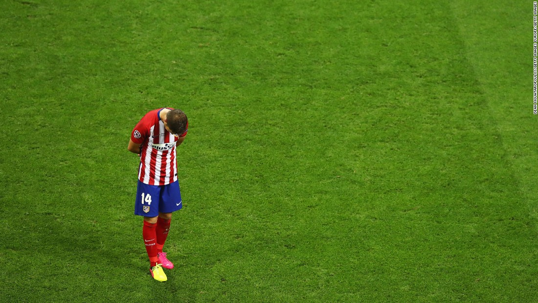 Gabi of Atletico Madrid stands on the pitch after his team lost.