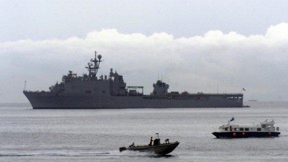 Local boats pass beside USS Harpers Ferry in the southern Philippines on May 30, 2007.