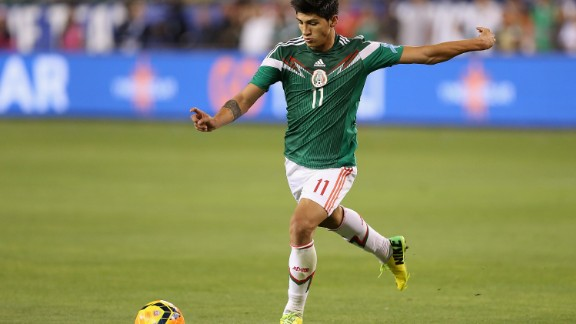 GLENDALE, AZ - APRIL 02:  Alan Pulido #11 of Mexico handles the ball during the International Friendly against USA at University of Phoenix Stadium on April 2, 2014 in Glendale, Arizona. Mexico and USA played to a 2-2 tie.  (Photo by Christian Petersen/Getty Images)