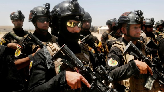 Iraqi forces gather ahead of an operation to retake Falluja on Sunday, May 29.