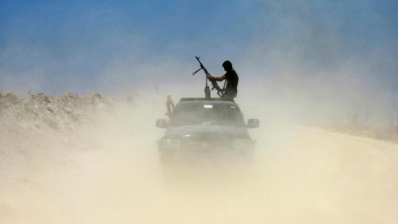 A fighter from a Shiite militia takes a combat position outside Falluja on May 23.