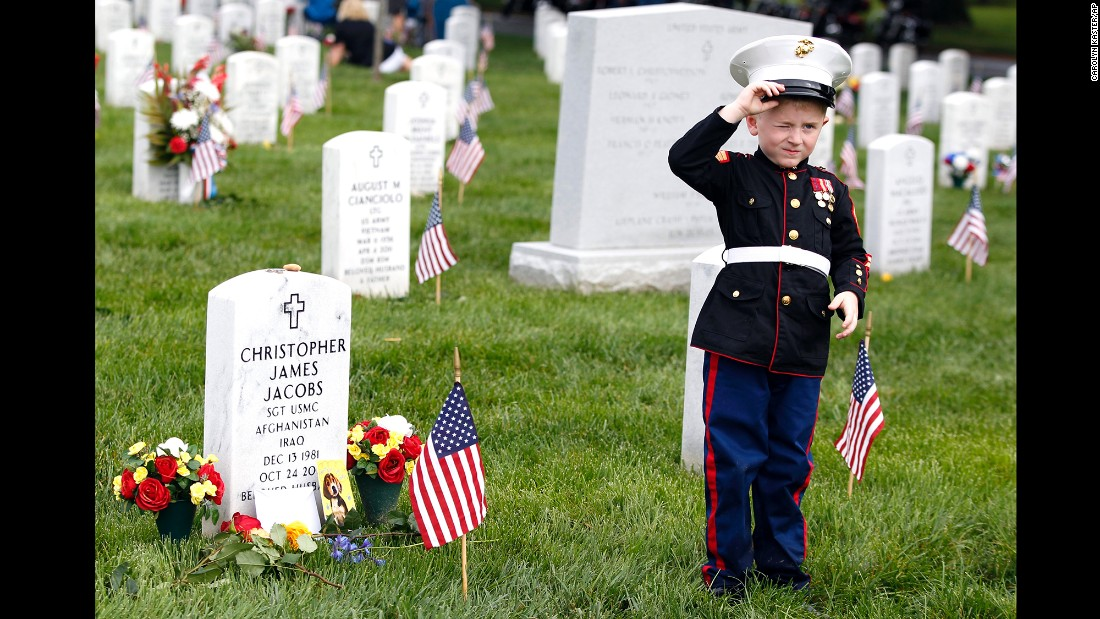 Christian Jacobs, a 5-year-old from Hertford, North Carolina, stands next to his father's gravestone at Arlington National Cemetery on May 30. Marine Sgt. Christopher James Jacobs died in a training accident in 2011.