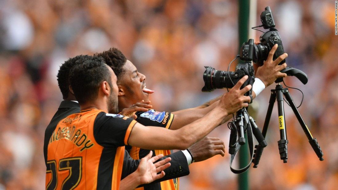 "Hull City players take a selfie Saturday, May 28, after winning the playoff final of the Championship, which is the second tier of English soccer. Hull defeated Sheffield Wednesday 1-0 in London, <a href=""http://www.cnn.com/2016/05/28/sport/hull-city-sheffield-wednesday-premier-league/"" target=""_blank"">securing a return to the Premier League.</a>"