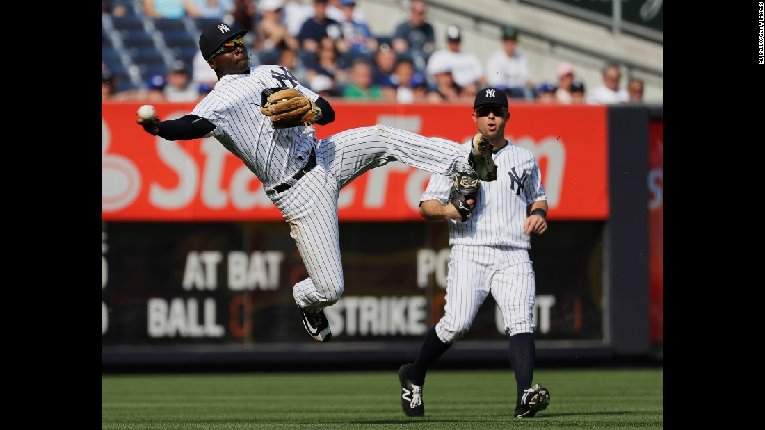 Didi Gregorius, shortstop for the New York Yankees, makes a leaping throw during a game against Toronto on Thursday, May 26.