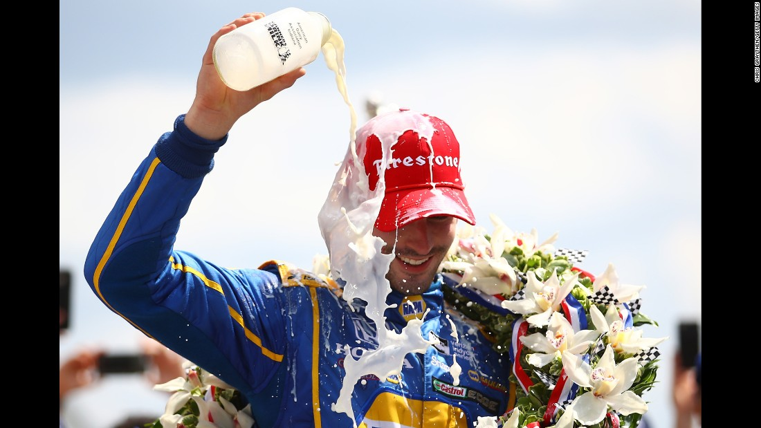 Alexander Rossi celebrates with the traditional bottle of milk after winning the Indianapolis 500 on Sunday, May 29. The rookie ran out of fuel on the last lap but held on for the victory.