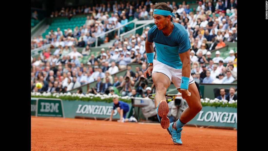 "Rafael Nadal hits a shot between his legs during a second-round match at the French Open on Thursday, May 26. By beating Facundo Bagnis, Nadal became the eighth man in history <a href=""http://www.cnn.com/2016/05/26/tennis/french-open-rafael-nadal-novak-djokovic-tennis/"" target=""_blank"">to record 200 wins at Grand Slams.</a> But a wrist injury forced him to withdraw from the tournament the next day."