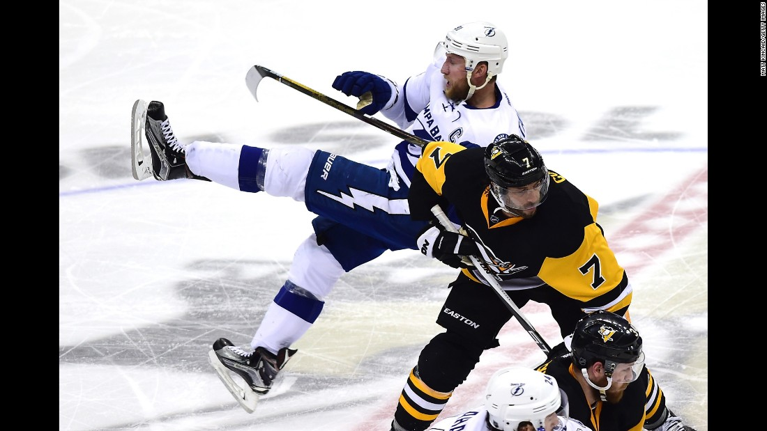Tampa Bay's Steven Stamkos, top, falls to the ice after colliding with Pittsburgh's Matt Cullen during Game 7 of the NHL's Eastern Conference Final on Thursday, May 26. Pittsburgh won 2-1 to clinch a spot in the Stanley Cup Final against San Jose.