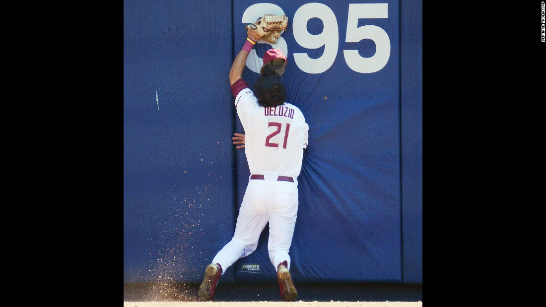 Florida State outfielder Ben DeLuzio runs into the center-field wall after making a catch in the ACC tournament on Wednesday, May 25. His face was cut on the play, but he stayed in the game as the Seminoles defeated North Carolina State 7-3.