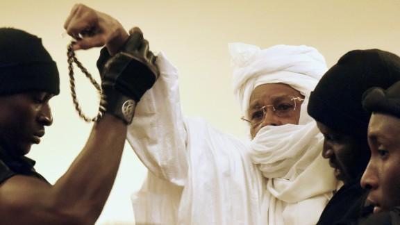 Prison guards escort ex-Chadian dictator Hissene Habre into court when his trial first began in July in Dakar, Senegal.