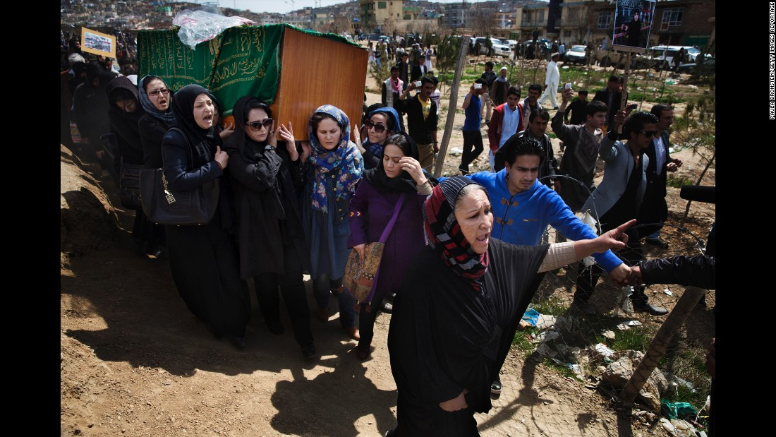 The casket of Farkhunda Malikzada is carried by relatives, friends and women's rights activists in March 2015. Malikzada was killed by a mob in the center of Kabul, Afghanistan, after being falsely accused of desecrating a Quran.