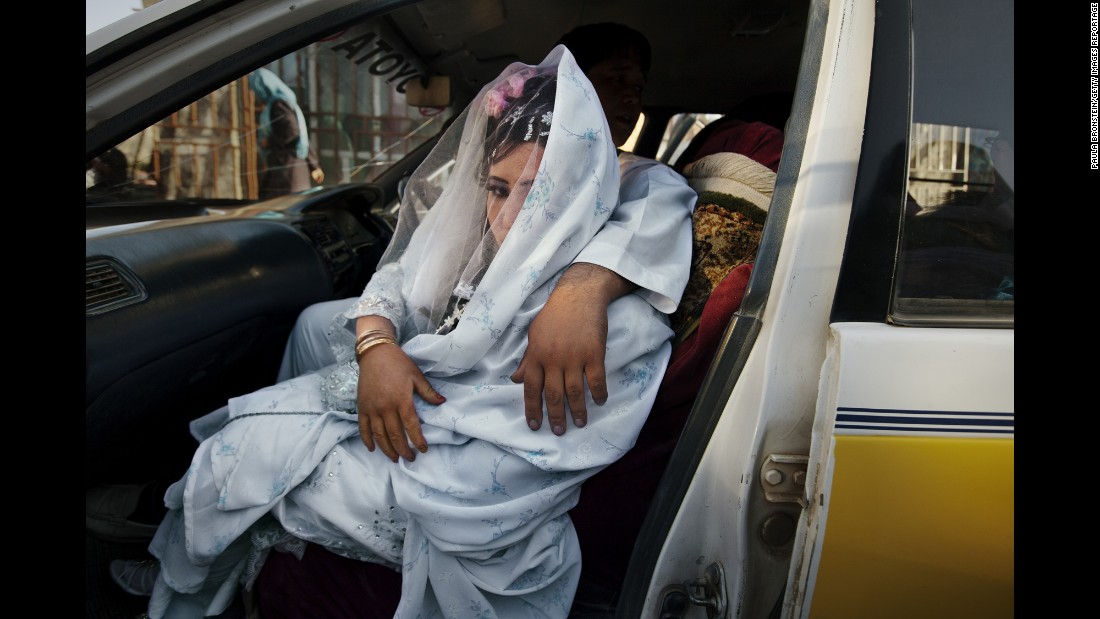 Zahara, 24, is held by her fiance, Gulam Ali, as they leave for a wedding ceremony in Bamiyan, Afghanistan, in October 2010.