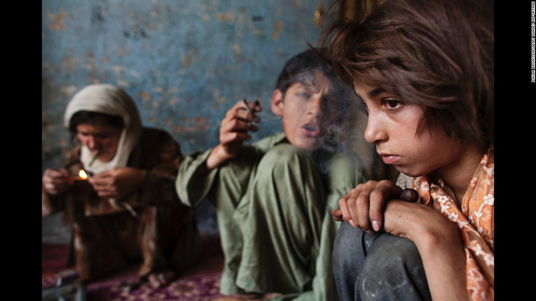 Gulparai, 11, sits next to her brother and mother as they use heroin in August 2007.