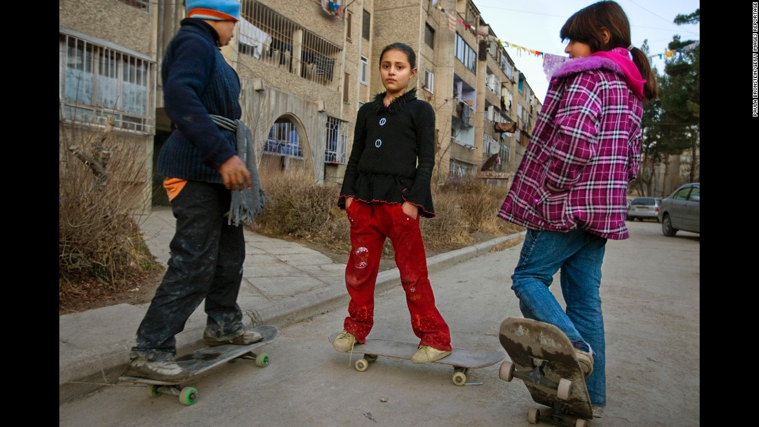 Children skateboard around a middle-class neighborhood in Kabul in January 2009.